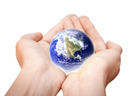 business symbols: human hands carefully holding Earth planet  Glass World