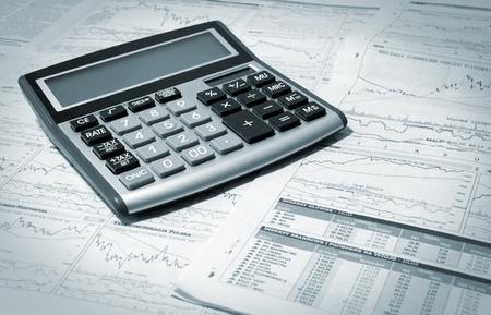 financial graph: Calculator On A Financial Newpaper  Shot in studio