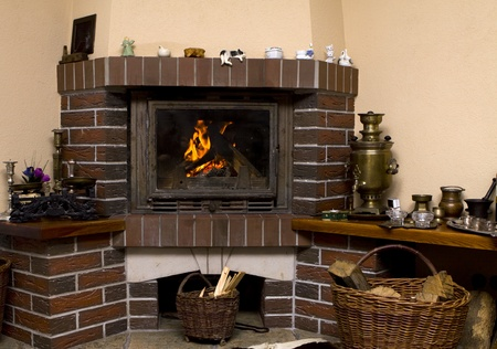 Wood fire in an old style wooden log cabin Stock Photo - 13247181