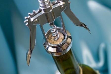 Close shot of a corkscrew opening a bottle of wine  Shallow dof Stock Photo - 13247084