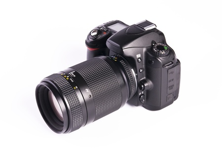 A DSLR camera mounted with a pro lens standard zoom  photo