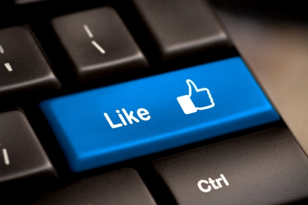Blue thumb up like button on the keyboard Stock Photo - 13613196