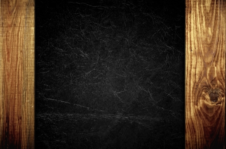 leather background: The black leather with wooden panels background texture