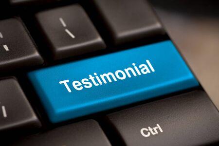 The word Testimonial on return key of keyboard  photo