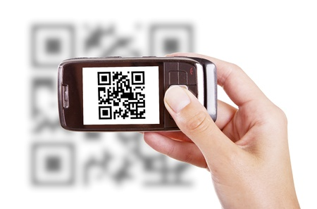 Human hands holding smart phone and scanning QR code Stock Photo - 14941869