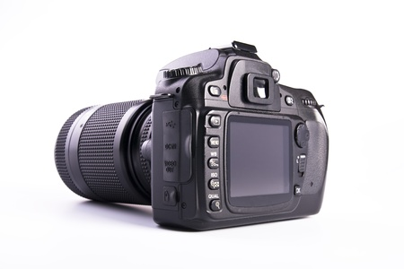 black and white photography: A DSLR camera mounted with a pro lens standard zoom
