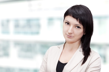 clean modern portrait of a young professional business woman with ample copyspace  photo