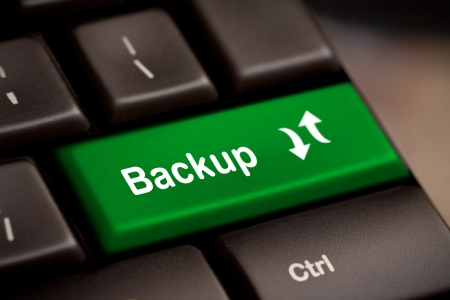 backups: Backup Computer Key In Green For Archiving And Storage