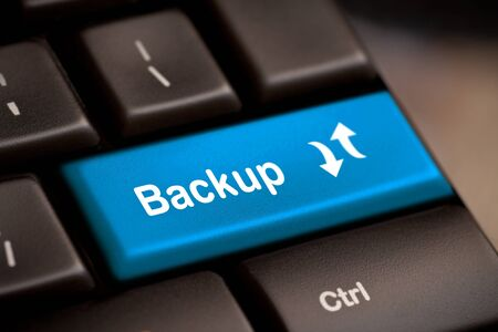 backups: Backup Computer Key In Blue For Archiving And Storage