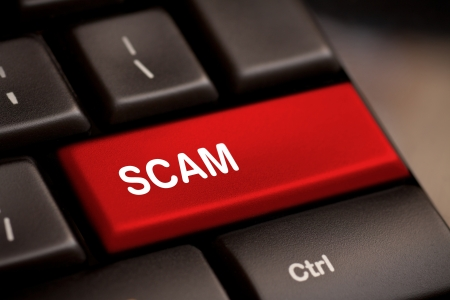 fraud: Scam Computer Keys Showing Swindles And Fraud Stock Photo