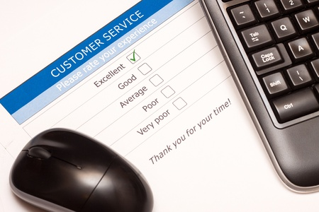 Excellent checkbox on customer service satisfaction survey with keyboard and mouse Stock Photo - 15056974