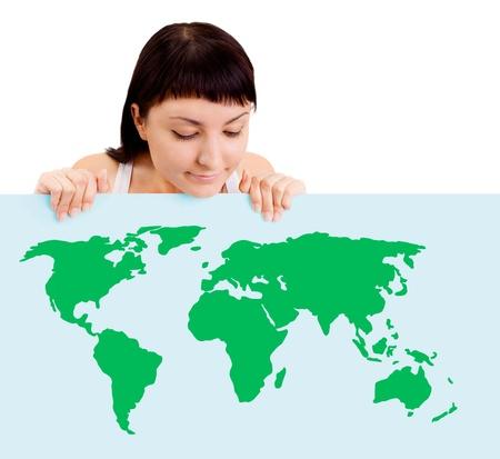 Woman smiling showing earth globe on billboard Stock Photo - 15036424