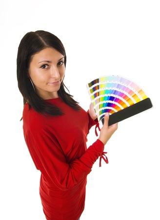 graphics: La foto de una mujer joven sosteniendo gu�a de color Foto de archivo