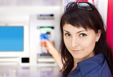 pincode: Beautiful woman using credit card, she is withdrawing money from an ATM machine