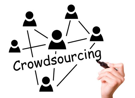 crowd sourcing: Business man drawing crowdsourcing concept to screen