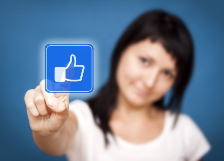 Woman is touching the like button - Social Media  photo
