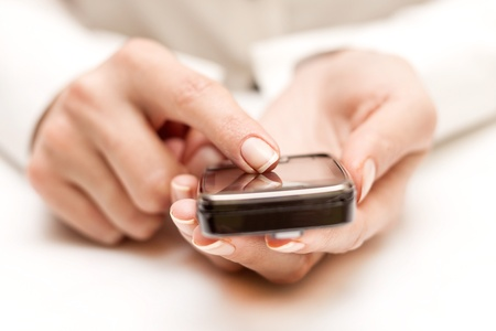 portable information device: Closeup of female hands using a smart phone