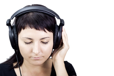 Young woman with headphones, enjoying nice music  photo