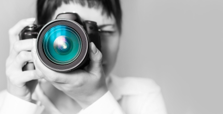 slr camera: Pretty woman is a professional photographer with dslr camera Stock Photo