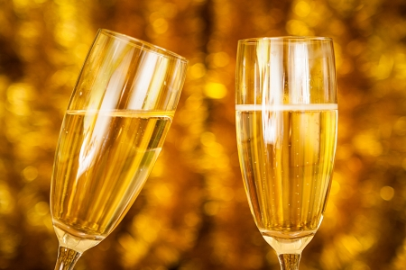 Two Champagne Glasses with golden background photo