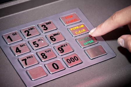 atm: ATM machine keypad numbers  Entering atm cash machine pin code Stock Photo