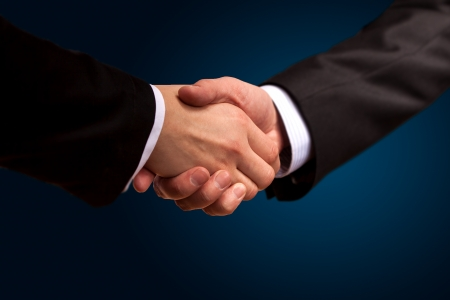 Closeup of a business hand shake between two colleagues Stock Photo