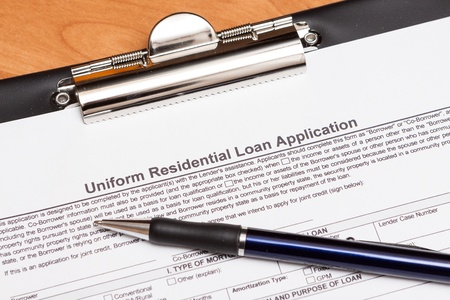 Mortgage loan application form on the table Stock Photo - 16442962