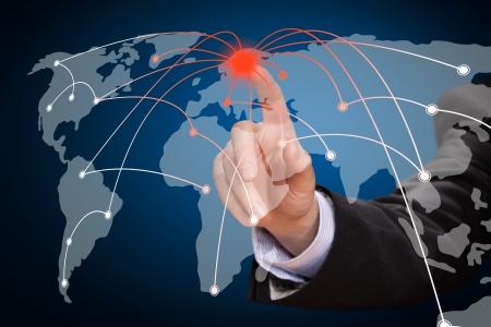pushing the button: Business man touching world map screen  Social network  Stock Photo