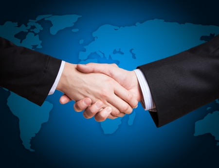 done: Closeup of a business hand shake between two colleagues Stock Photo