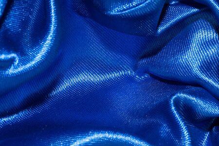 rippled: Blue satin textile background  Texture closeup Stock Photo