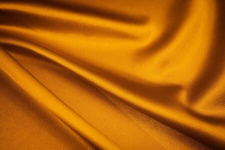 luxurious gold satin background closse up photo