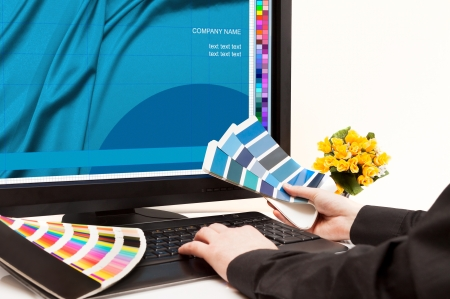ral: Graphic designer at work  Color samples  Stock Photo