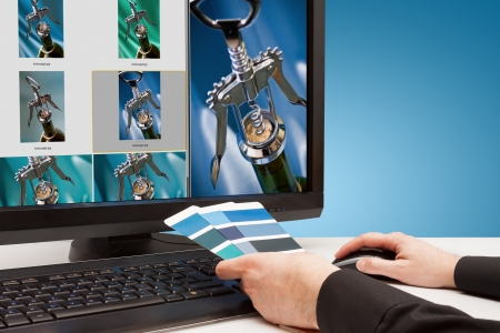 Graphic designer at work  Color samples blue  Select photos picture Stock Photo - 18350673