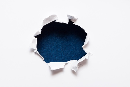 Breakthrough paper hole with black textured background  Stock Photo