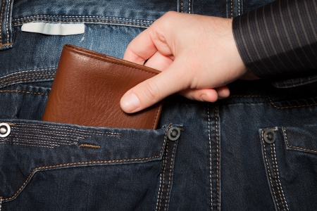 hand in pocket: Stealing wallet from back pocket Stock Photo