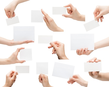 Collection of blank cards in a hand isolated on white photo
