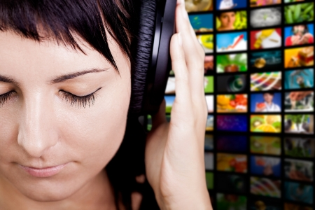 listen music: Young woman with headphones, enjoying nice music