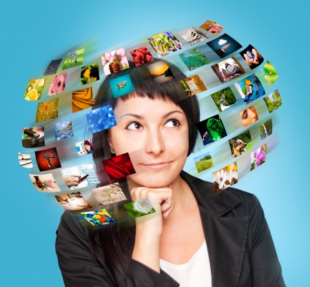 A technology woman has images around his head  Use it for a communication or tv concept   photo