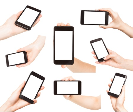 Hands holding smart phones isolated on white background photo