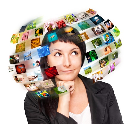 cable tv: A technology woman has images around his head  Use it for a communication or tv concept