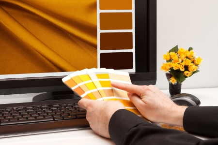 ral: Graphic designer at work  Color samples  Brown, yellow images Stock Photo