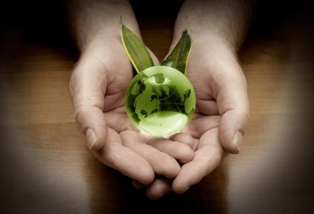 glass globe in hand photo