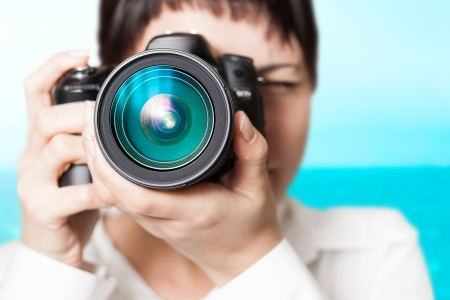 dslr camera: Pretty woman is a professional photographer with dslr camera Stock Photo
