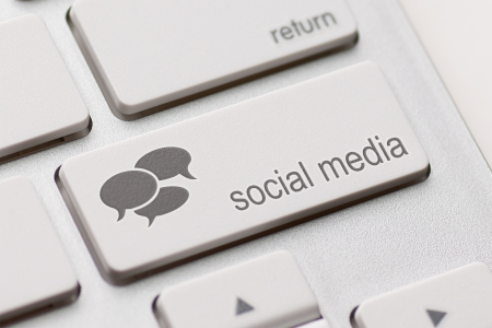 social issue: Social Media button on a keyboard with speech bubbles