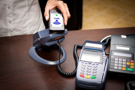 technology transaction: NFC - Near field communication   mobile payment Stock Photo