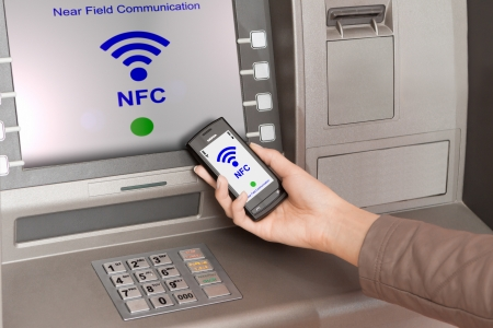 cashpoint: withdrawing money from atm with a mobile phone a NFC terminal