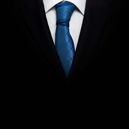 tie tuxedo: Black business suit with a tie