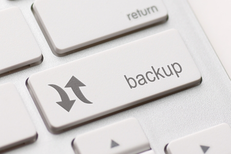 backing up: Backup Computer Key In For Archiving And Storage Stock Photo