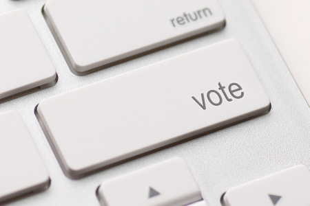 people voting: democracy concept with vote button on keyboard Stock Photo