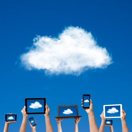 cloud computing concept  hands holding computer laptop smart phone tablet and touch pad  photo